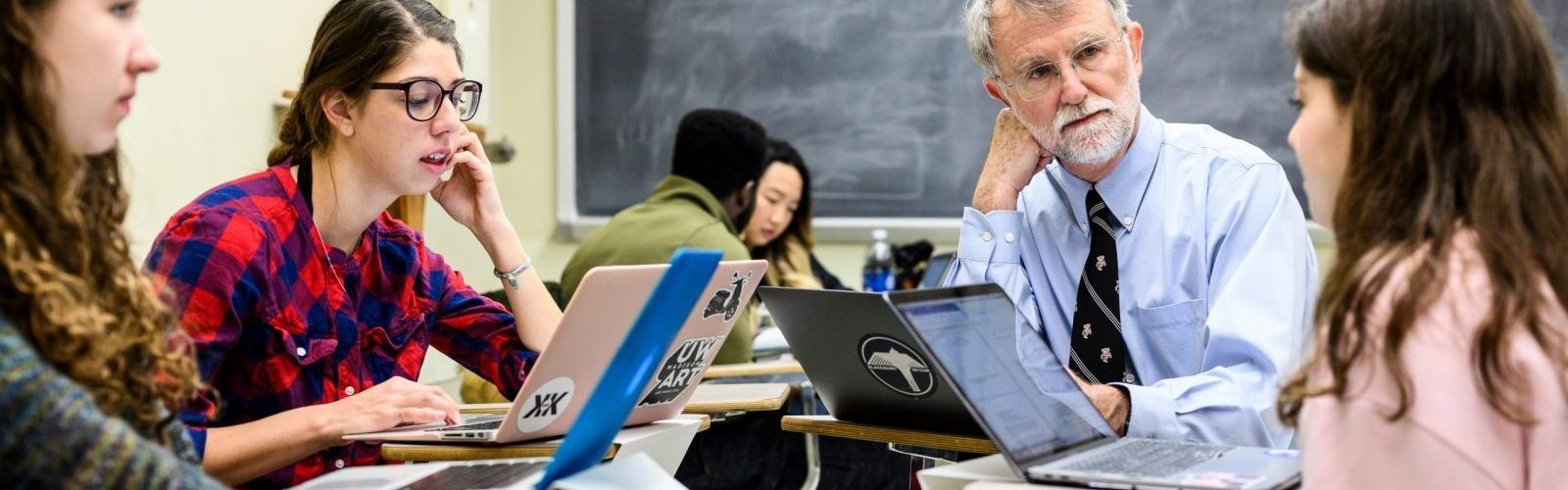 Patrick Remington, professor of population health sciences and associate dean in the School of Medicine and Public Health, participates in a group discussion with students.