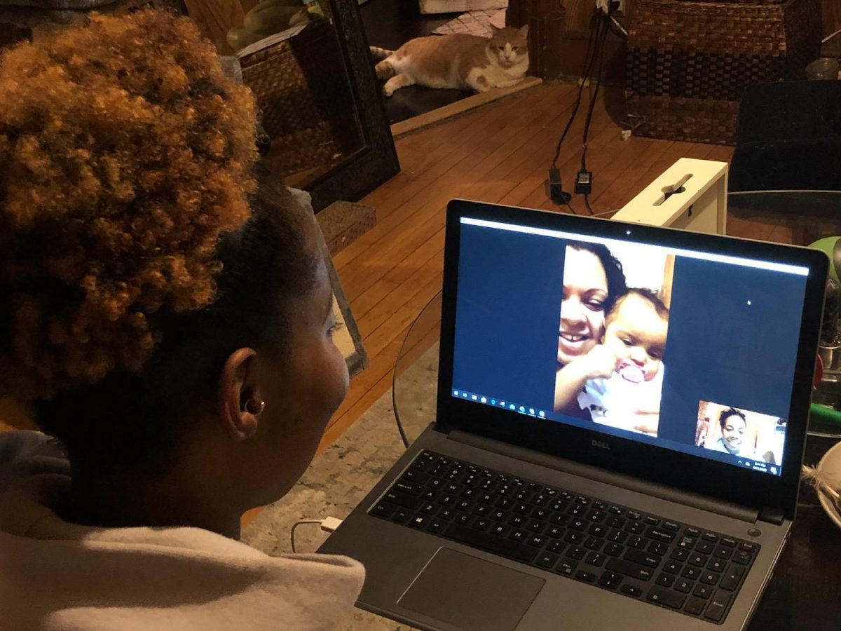 AABN staff member meeting with a family over a video conferencing system.